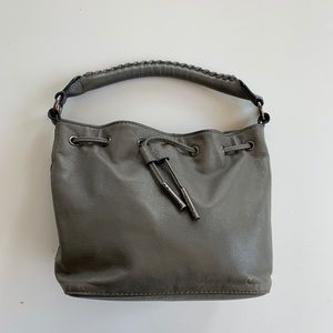 Grey Elliott Lucca purse with shoulder strap.